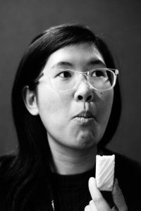 Portrait of Joanne Loo, holding a lemon bar. Taken by Esmond Sit.